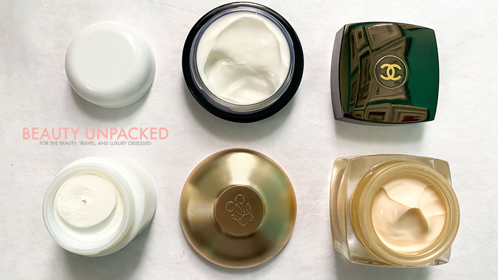 photo by Beauty Unpacked, Angela Malicki personal collection,  Luxury creams Left to Right - Creme de La Mer $95-$2400, Guerlain Orchidee Anti-aging cream $480, CHANEL Sublimage $400